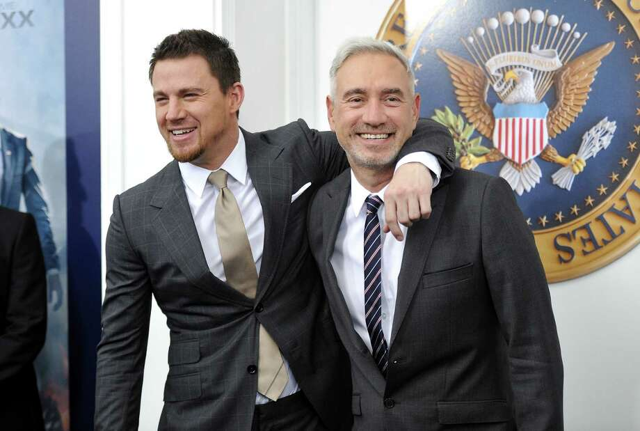 "Actor Channing Tatum, left, and director Roland Emmerich attend the ""White House Down"" premiere at the Ziegfeld Theatre on Tuesday, June 25, 2013 in New York. (Photo by Evan Agostini/Invision/AP) ORG XMIT: NYEA127 Photo: Evan Agostini, AP / Invision"