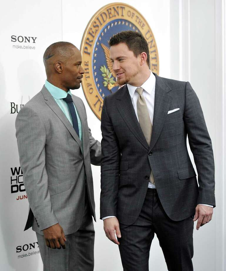 "Actors Jamie Foxx, left, and Channing Tatum attend the ""White House Down"" premiere at the Ziegfeld Theatre on Tuesday, June 25, 2013 in New York. (Photo by Evan Agostini/Invision/AP) ORG XMIT: NYEA125 Photo: Evan Agostini, AP / Invision"