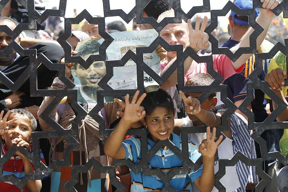 "Can I get an autograph and a Jaws of Life team? Fans wait for  Palestinian ""Arab Idol"" winner Mohammed Assaf to arrive at the Rafah crossing in the southern Gaza Strip. Photo: Said Khatib, AFP/Getty Images"