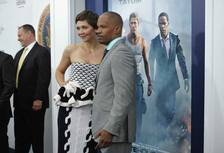 "Actors Maggie Gyllenhaal and Jamie Foxx attend the ""White House Down"" premiere at the Ziegfeld Theatre on Tuesday, June 25, 2013 in New York. (Photo by Evan Agostini/Invision/AP) ORG XMIT: NYEA122 Photo: Evan Agostini, AP / Invision"
