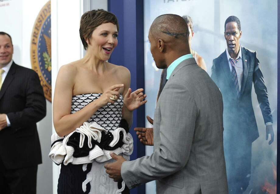 "Actors Maggie Gyllenhaal and Jamie Foxx attend the ""White House Down"" premiere at the Ziegfeld Theatre on Tuesday, June 25, 2013 in New York. (Photo by Evan Agostini/Invision/AP) ORG XMIT: NYEA123 Photo: Evan Agostini, AP / Invision"