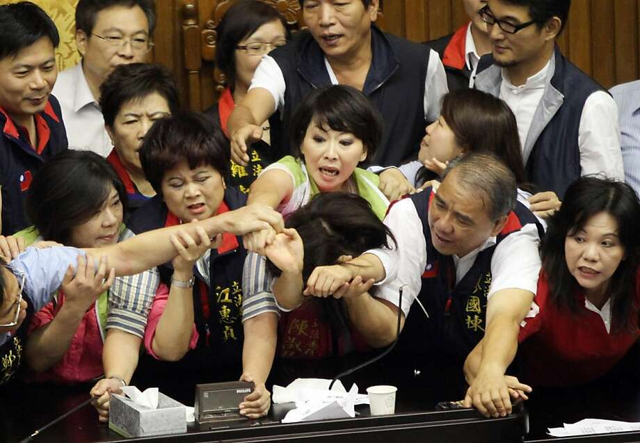 Brew-haha in parliament:In Taipai, legislators from Taiwan's ruling Kuomintang party and opposition brawl in a no-holds-barred attempt to seize the podium. Some reportedly threw coffee on their fellow lawmakers. Photo: Stringer, AFP/Getty Images