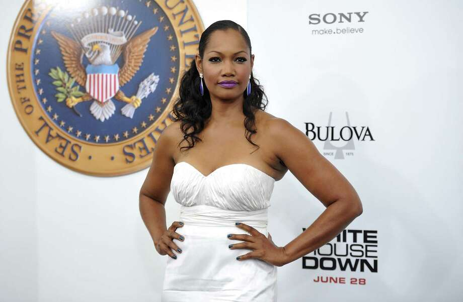 "Actress Garcelle Beauvais attends the ""White House Down"" premiere at the Ziegfeld Theatre on Tuesday, June 25, 2013 in New York. (Photo by Evan Agostini/Invision/AP) ORG XMIT: NYEA116 Photo: Evan Agostini, AP / Invision"
