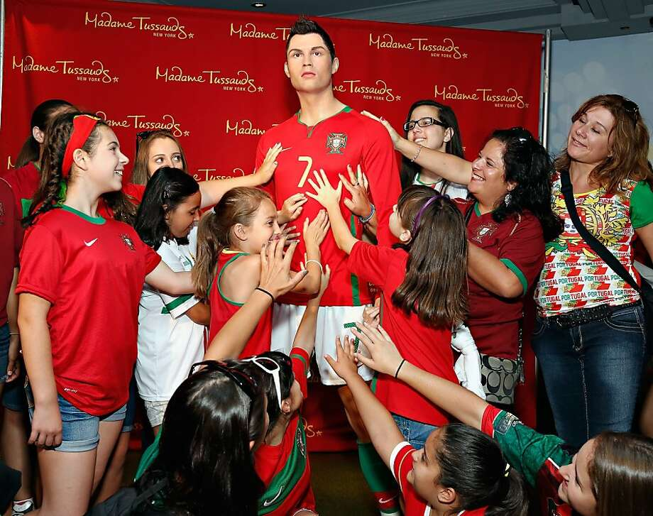 Easy girls, you're going to melt him: Students of Escola Lusitania, the Portuguese School of the Portuguese Club of Long Branch, can't keep their hands off a waxwork of soccer superstar Cristiano Ronaldo at Madame Tussauds New York. Photo: Cindy Ord, Getty Images For Madame Tussauds