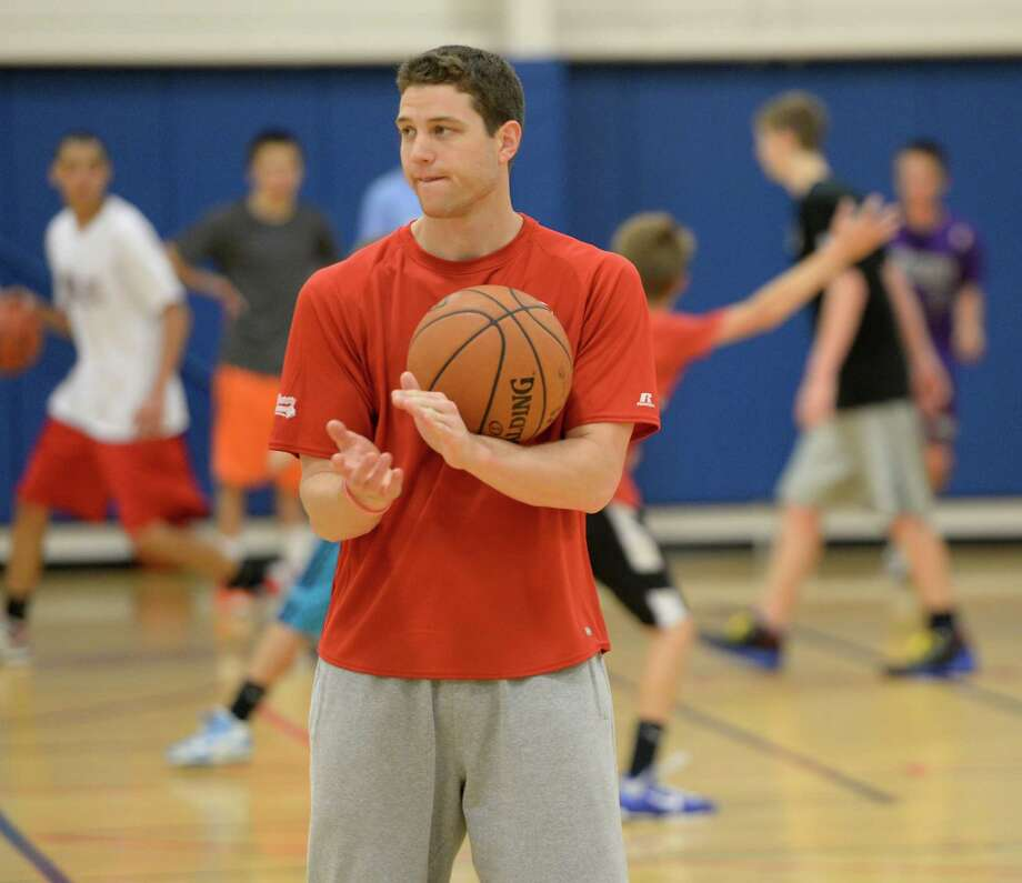 Former Glens Falls High basketball star Jimmer Fredette, now with the NBA's Sacramento  Kings, works with kids June 26, 2013, at his basketball camp at the Saratoga Springs Rec Center in Saratoga Springs, N.Y. ( Skip Dickstein/Times Union ) Photo: Skip Dickstein / 00022950A