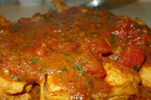 Meal: Chicken with red sauce and cake