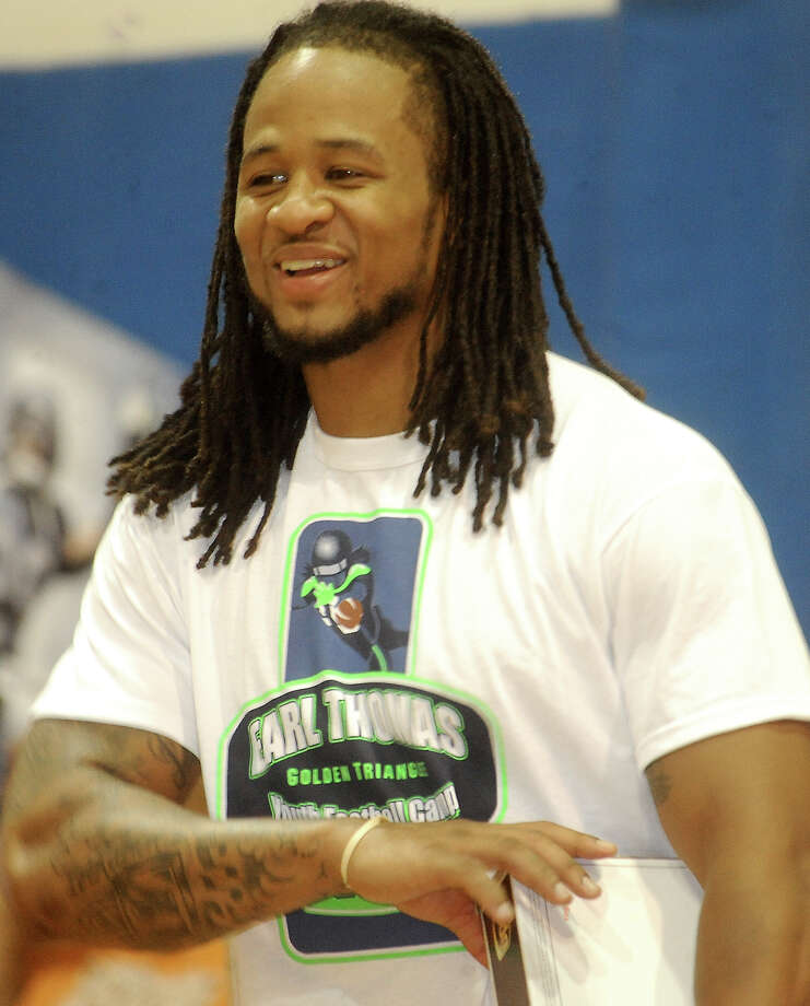 NFL player, Earl Thomas attends a special presentation at his football camp at West Orange-Stark High School in West Orange, Saturday, July 7, 2012.Tammy McKinley/The Enterprise Photo: TAMMY MCKINLEY
