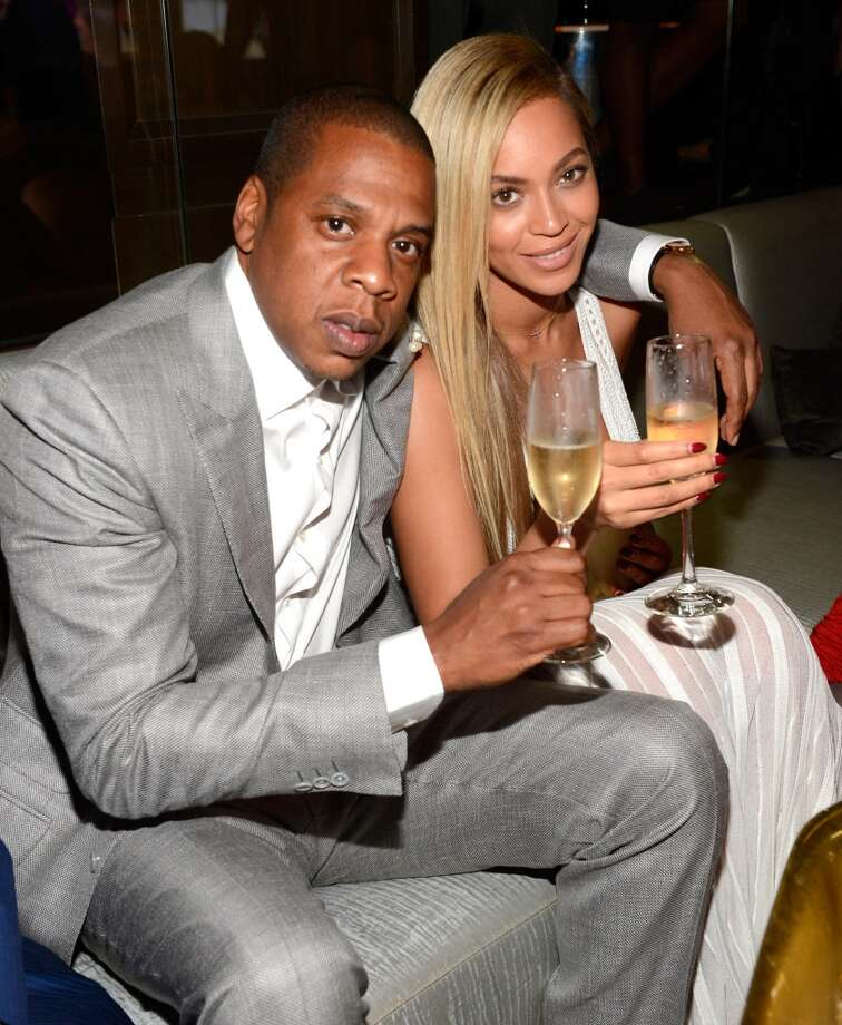 Jay-Z and Beyonce party like rock stars.  (Photo by Kevin Mazur/Getty Images)
