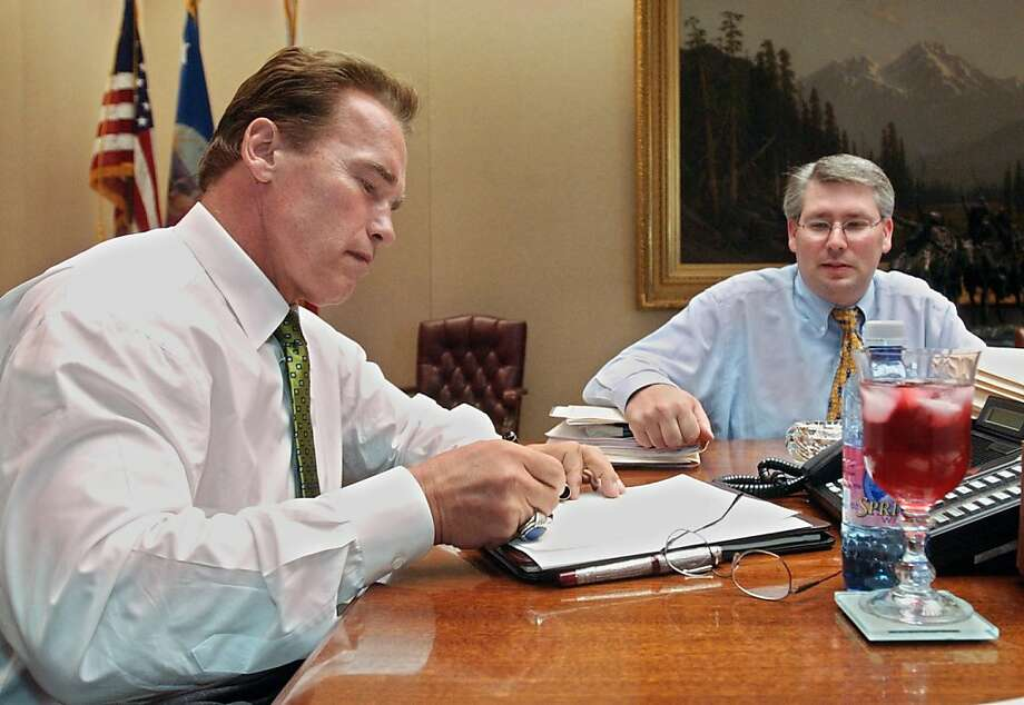 Gov. Arnold Schwarzenegger (left), shown with aide Richard Costigan, vetoed two same-sex-marriage bills. Photo: Rich Pedroncelli, AP