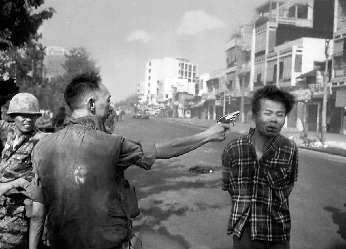 South Vietnamese Gen. Nguyen Ngoc Loan, chief of the national police, fires his pistol, shoots, executes into the head of suspected Viet Cong officer Nguyen Van Lem (also known as Bay Lop) on a Saigon street Feb. 1, 1968, early in the Tet Offensive.