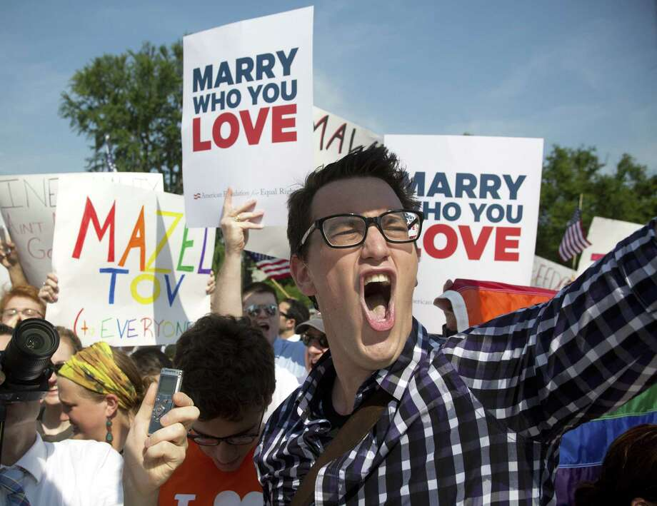 Supporters of gay marriage rally in Washington after the Supreme Court's decision to strike down the Defense of Marriage Act on Wednesday. Photo: Stephen Crowley, New York Times