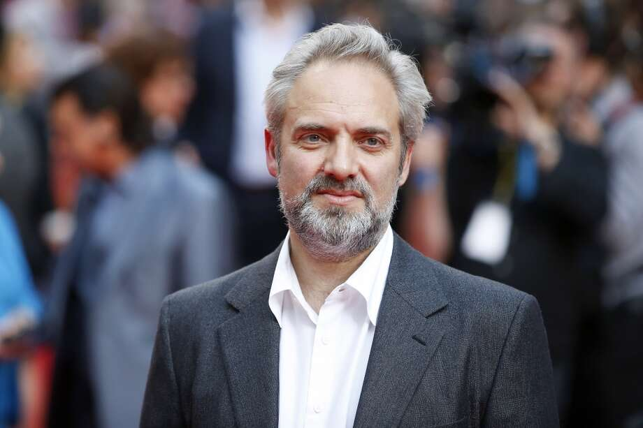 British stage and film director Sam Mendes poses for photographers while arriving for the Premiere of West End musical Charlie and the Chocolate Factory, at the Theatre Royal, in central London on June 25, 2013. AFP PHOTO / JUSTIN TALLIS        (Photo credit should read JUSTIN TALLIS/AFP/Getty Images)