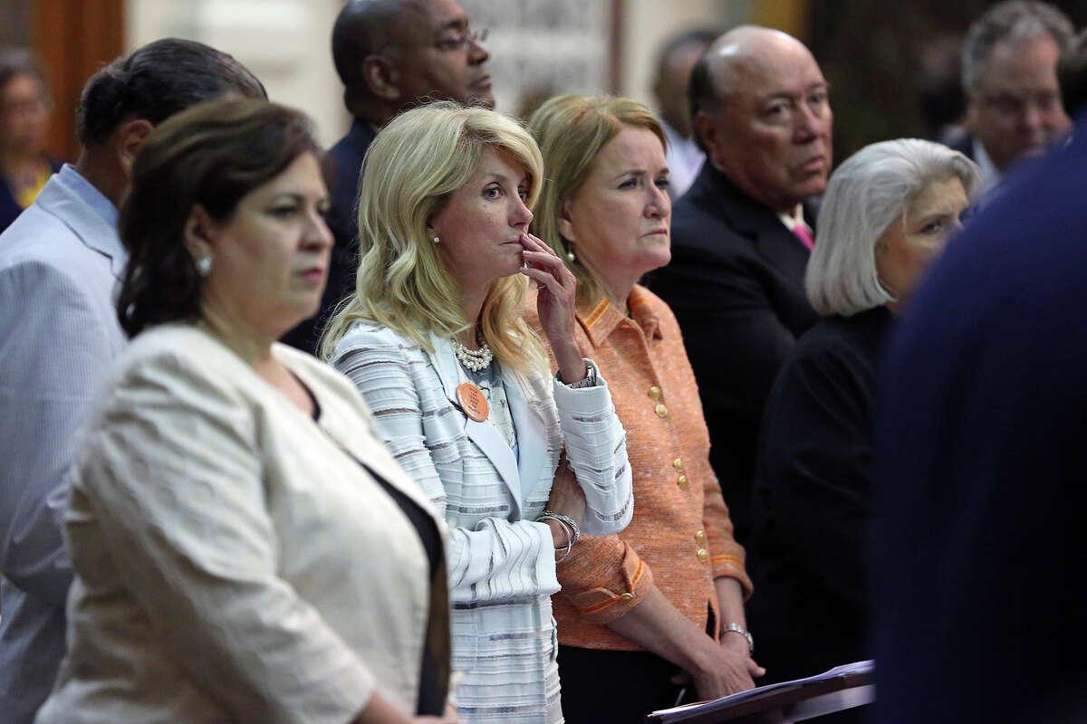 State Sen. Wendy Davis, center, and state Sen. Leticia Van de Putte, left, spoke out against Senate Bill 5 during a marathon session of the Legislature Tuesday.