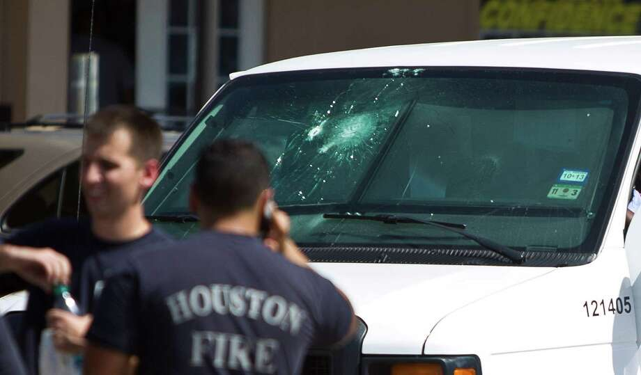 Authorities process the scene where an armored truck was fired upon at the 2300 block of Wirt Road, Wednesday, June 26, 2013, in Houston.  Photo: Nick De La Torre, Houston Chronicle / © 2013  Houston Chronicle