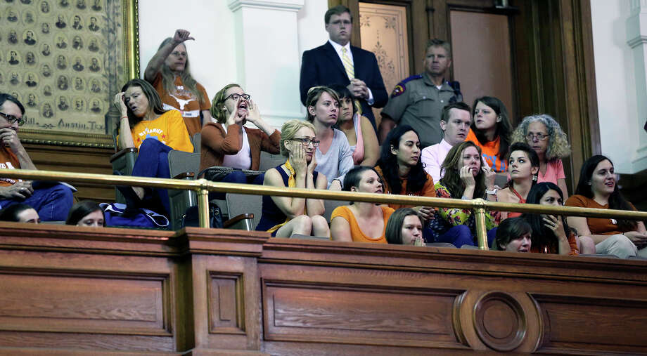 Supporters begin to be loud as Fort Worth Senator Wendy Davis filibusters in an effort to cause abortion legislation to die without a vote on the floor of the Senate Tuesday, June 25, 2013. Photo: Tom Reel, San Antonio Express-News