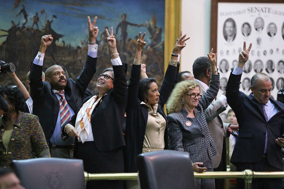 House Democrats cheer on the crowd after Fort Worth Senator Wendy Davis filibusters in an effort to cause abortion legislation to die without a vote on the floor of the Senate Tuesday, June 25, 2013. Photo: Tom Reel, San Antonio Express-News