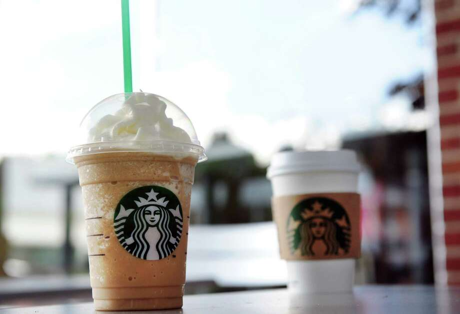 Starbucks baristas must share their tips with shift supervisors, but assistant managers are left out in the cold, New York's highest court ruled Wednesday. Photo: Autumn Driscoll / Connecticut Post