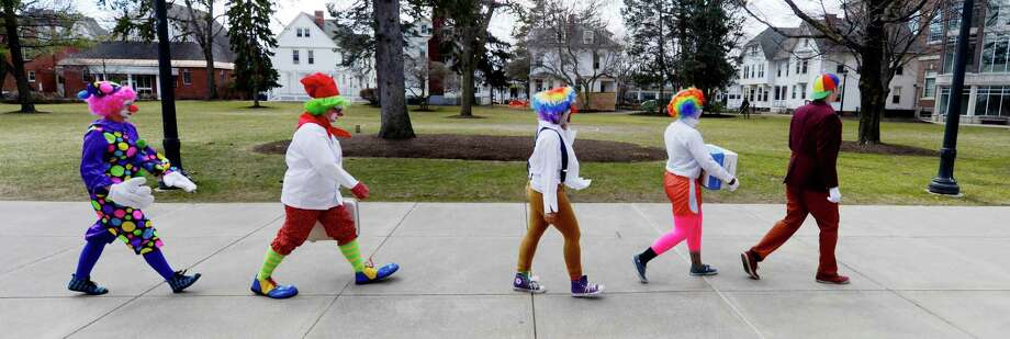 The  class makes a trip across campus at St. Rose on the way to a gathering where they will show off their clown skills. (Skip Dickstein / Times Union) Photo: SKIP DICKSTEIN / 00021812A