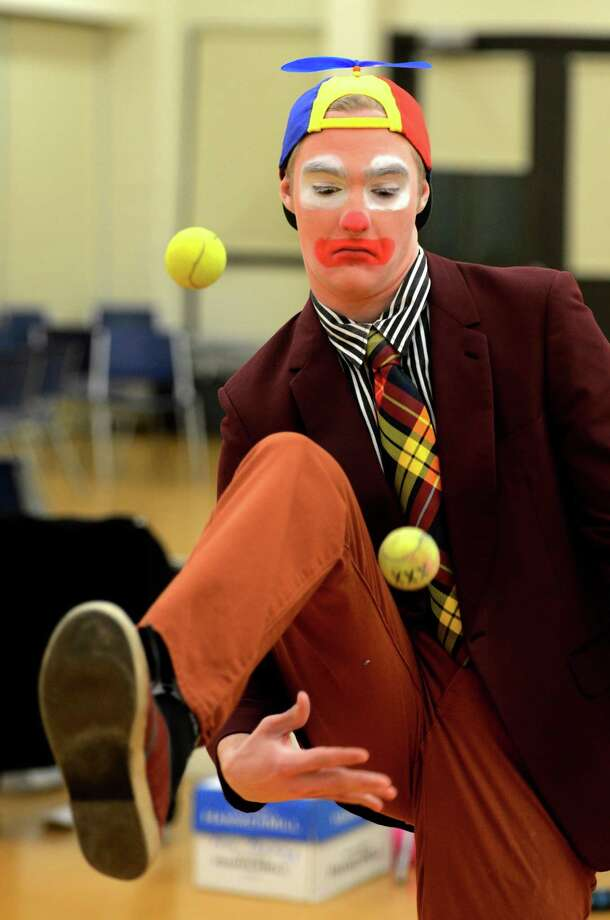 Student Kevin Bohen juggles while in costume during the clowning class at St. Rose in Albany.  (Skip Dickstein / Times Union) Photo: SKIP DICKSTEIN / 00021812A