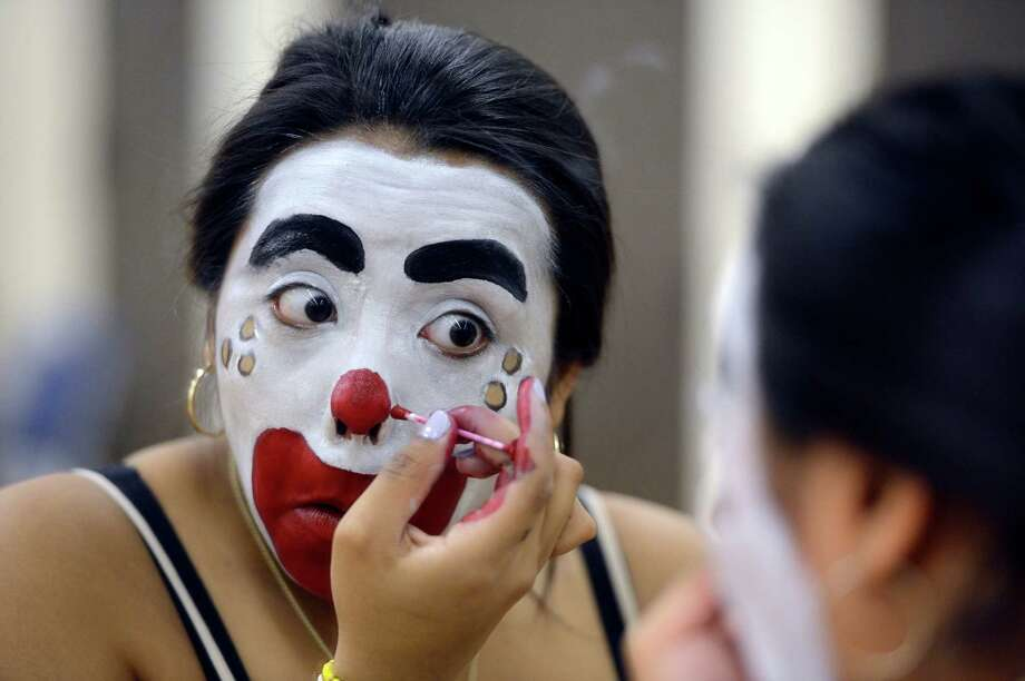 Jessica Lopez applies makeup during the clowning class at St. Rose  in Albany. Introduction to Clowning, a physical education course, is taught at The College 
