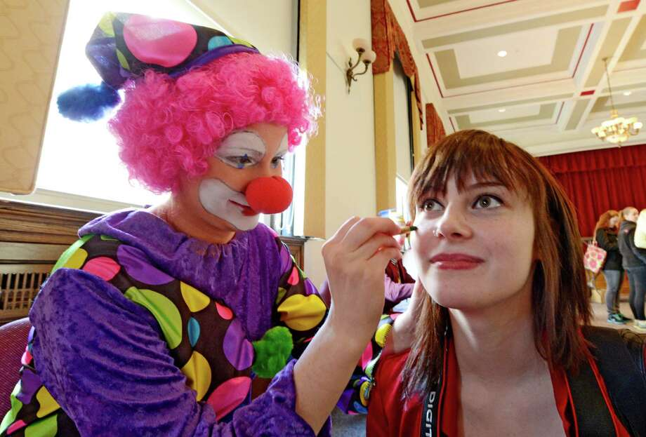 Briana O'Connor face paints her sister Jennifer O'Connor as part of her clowning class at St. Rose in Albany.  (Skip Dickstein/Times Union) Photo: SKIP DICKSTEIN / 00021812A