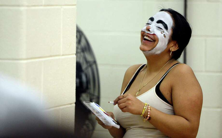 Student Jessica Lopez gets the giggles while applying makeup during the clowning class at St. Rose in Albany.  (Skip Dickstein / Times Union) Photo: SKIP DICKSTEIN / 00021812A