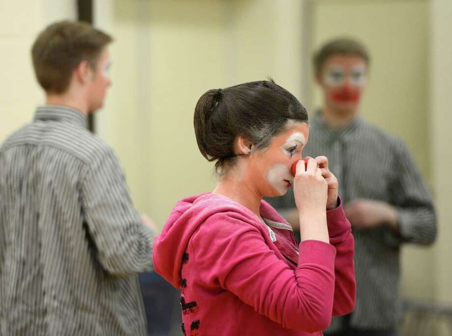 Briana O'Connor applies makeup during the clowning class at The College of St. Rose College in Albany.  (Skip Dickstein / Times Union) Photo: SKIP DICKSTEIN / 00021812A