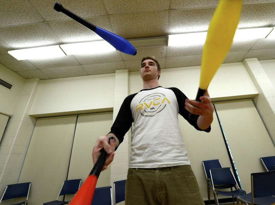 Student Kevin Bohen practices his juggling moves during the clowning class at St. Rose  in Albany.  (Skip Dickstein / Times Union) Photo: SKIP DICKSTEIN / 00021812A