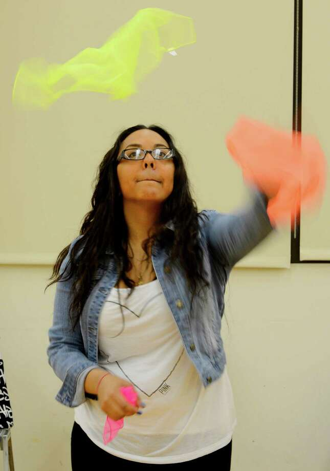 Student Jessica Lopez juggles scarves as part of her requirements in the clowning class at St. Rose in Albany. (Skip Dickstein / Times Union) Photo: SKIP DICKSTEIN / 00021812A
