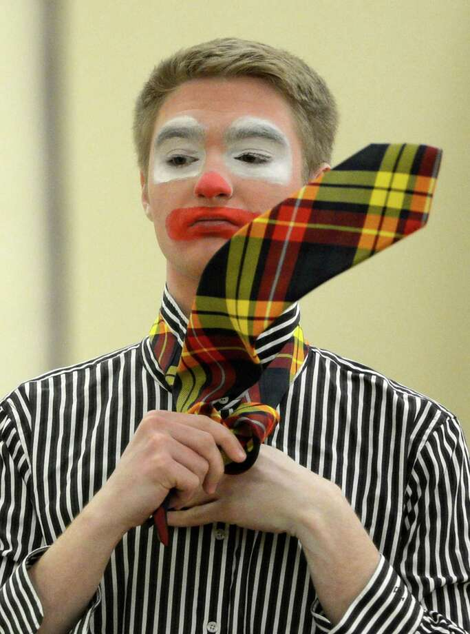 Student Kevin Bohen gets in to his costume during the clowning class at St. Rose  in Albany.  (Skip Dickstein / Times Union) Photo: SKIP DICKSTEIN / 00021812A
