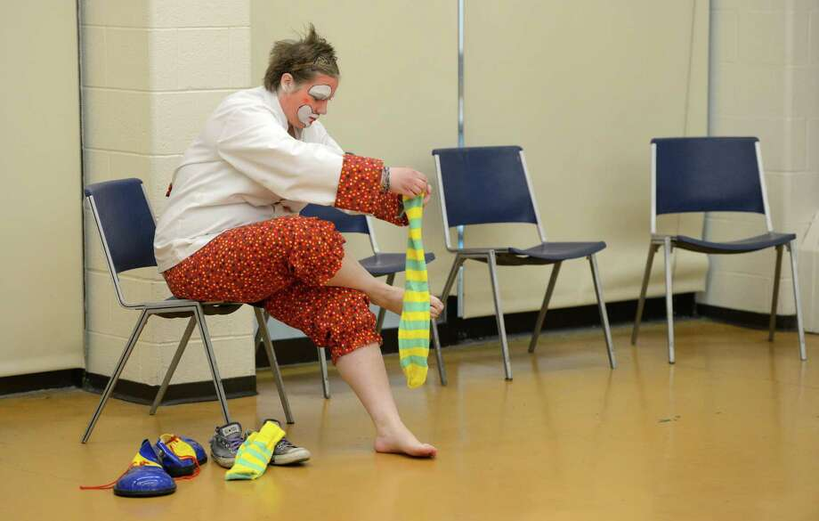 Student Molly McIver gets her costume on during the clowning class at St. Rose in Albany.  (Skip Dickstein / Times Union) Photo: SKIP DICKSTEIN / 00021812A
