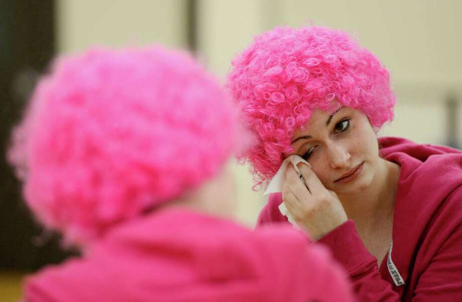 Briana O'Connor applies makeup during the clowning class at St. Rose College in Albany, N.Y.  (Skip Dickstein/Times Union) Photo: SKIP DICKSTEIN / 00021812A