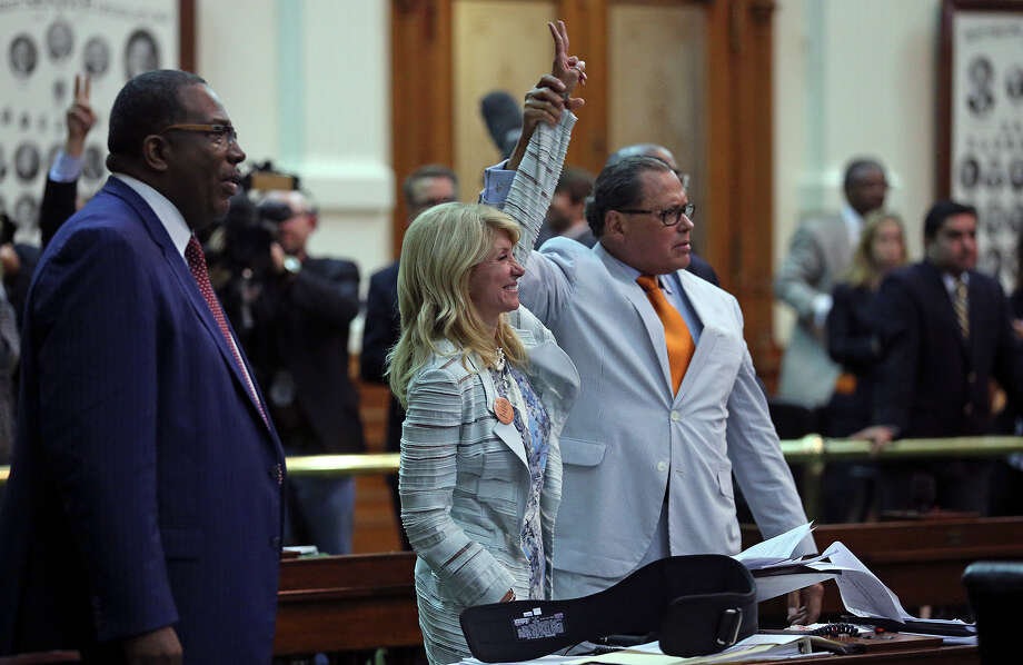 Fort Worth Senator Wendy Davis signals a no vote after she filibusters in an effort to cause abortion legislation to die without a vote on the floor of the Senate Tuesday, June 25, 2013. Photo: TOM REEL