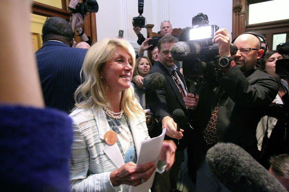 Fort Worth Senator Wendy Davis makes an appearance outside the Senate Chamber after she filibusters in an effort to cause abortion legislation to die without a vote on the floor of the Senate Tuesday, June 25, 2013. Photo: TOM REEL