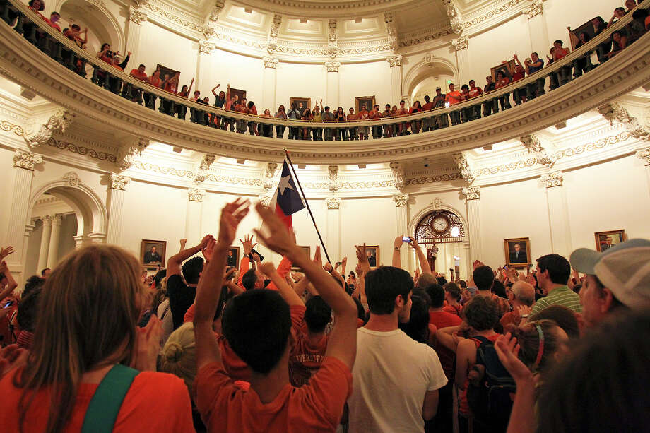 After preventing the Senate from taking a vote, abortion rights supporters gather in the capitol rotunda at 2 a.m. Wednesday.  Fort Worth Senator Wendy Davis had filibustered in an effort to cause abortion legislation to die without a vote on the floor of the Senate Tuesday, June 25, 2013. Photo: Tom Reel, San Antonio Express-News