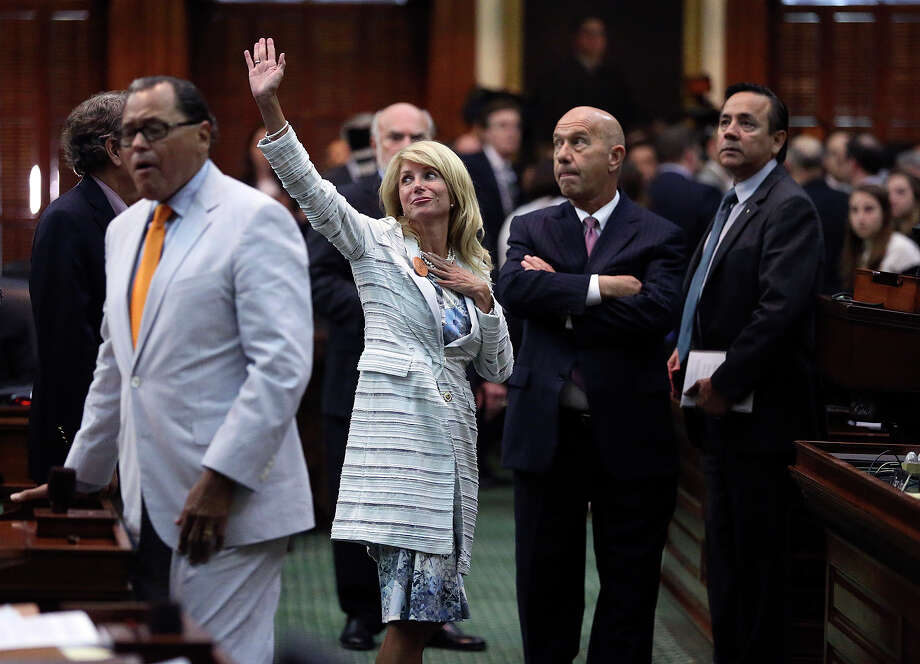 Fort Worth Senator Wendy Davis waves to supporters after a vote was taken after her filibuster in an effort to cause abortion legislation die without a vote on the floor of the Senate Tuesday, June 25, 2013. Photo: Tom Reel, San Antonio Express-News