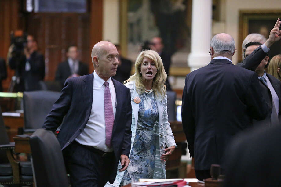 Senator John Whitmire rushes the podium  with Fort Worth Senator Wendy Davis after she filibusters in an effort to cause abortion legislation to die without a vote on the floor of the Senate Tuesday, June 25, 2013. Photo: Tom Reel, San Antonio Express-News