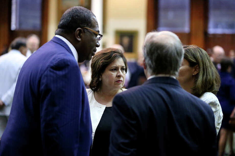 Democrats gather after a vote decision was made as Fort Worth Senator Wendy Davis filibusters in an effort to cause abortion legislation to die without a vote on the floor of the Senate Tuesday, June 25, 2013. Photo: Tom Reel, San Antonio Express-News