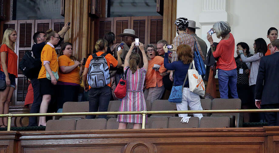 A supporter is arrested after Fort Worth Senator Wendy Davis filibusters in an effort to cause abortion legislation to die without a vote on the floor of the Senate Tuesday, June 25, 2013. Photo: Tom Reel, San Antonio Express-News