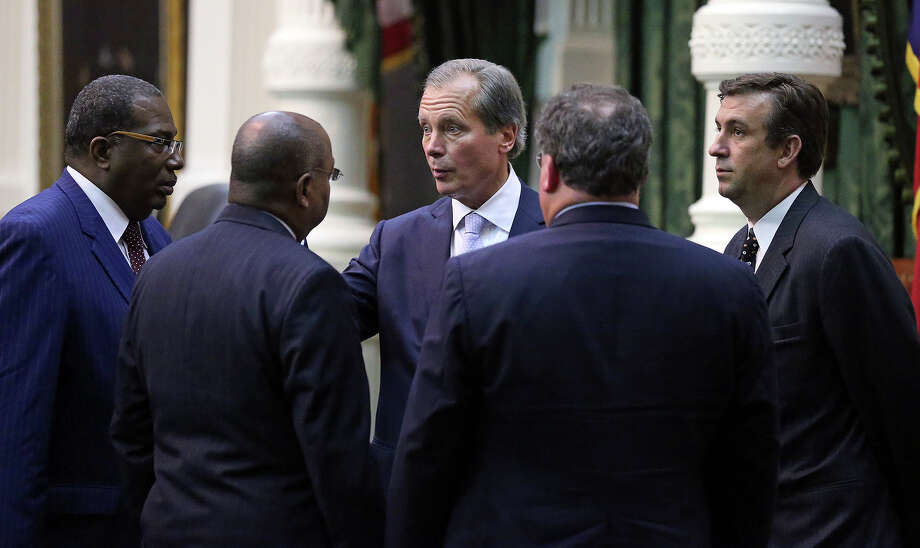 Lt. Governor David Dewhurst talks with Democrat leaders Royce West and Rodney Ellis after a vote was taken to pass abortion legislation after Fort Worth Senator Wendy Davis filibusters in an effort to cause abortion legislation die without a vote on the floor of the Senate Tuesday, June 25, 2013. Photo: Tom Reel, San Antonio Express-News