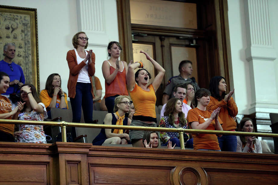 Supporters shout in the final minutes of the session as Fort Worth Senator Wendy Davis filibusters in an effort to cause abortion legislation to die without a vote on the floor of the Senate Tuesday, June 25, 2013. Photo: Tom Reel, San Antonio Express-News