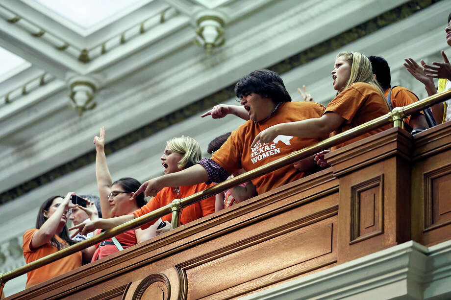 Protestors shout onto the floor after Fort Worth Senator Wendy Davis filibusters in an effort to cause abortion legislation to die without a vote on the floor of the Senate Tuesday, June 25, 2013. Photo: Tom Reel, San Antonio Express-News