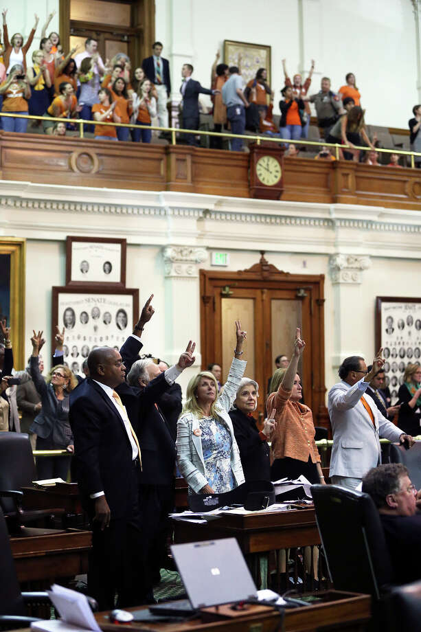 Fort Worth Senator Wendy Davis signals a no vote after she filibusters in an effort to cause abortion legislation to die without a vote on the floor of the Senate Tuesday, June 25, 2013. Photo: Tom Reel, San Antonio Express-News