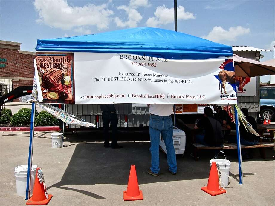 A new commemorative banner at Brooks' Place BBQ trailer in Cypress. Photo: Alison Cook