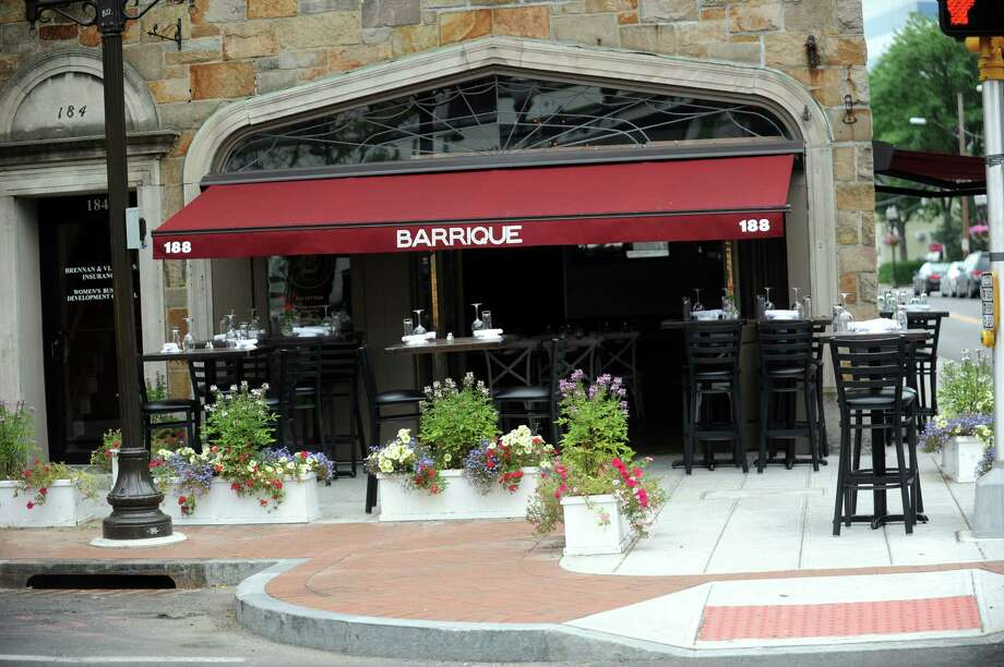 Barrique, a French/Mediterranean restaurant has a nice outdoor seating area with boxes of flowers next to the tables, at Stamford, Conn., Wednesday, June 26, 2013. Photo: Helen Neafsey / Greenwich Time