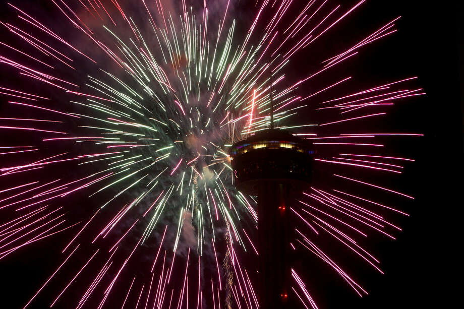 Fireworks burst next to the Tower of the Americas during the Stars & Stripes over San Antonio inaugural event on  July 4, 2012. Photo: Express-News File Photo