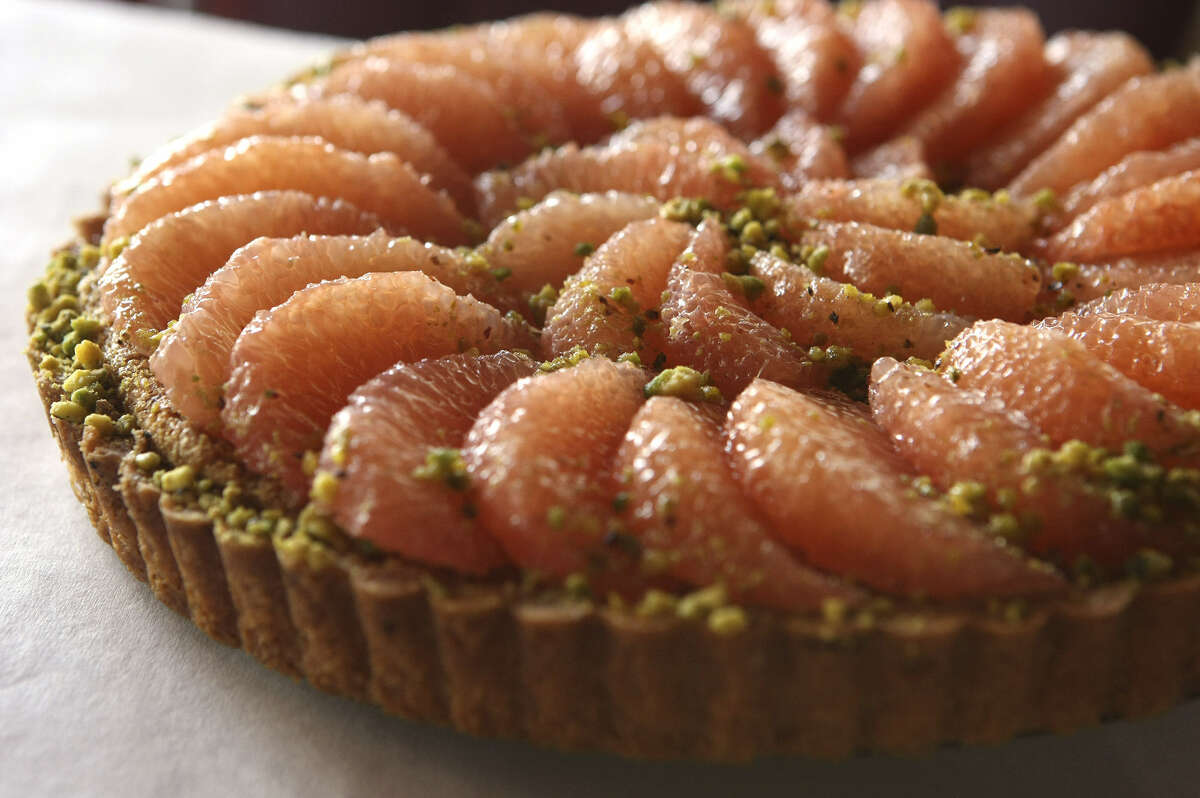 Pistachio and grapefruit tart at Chez Vatel & Bistro, where French cuisine and ambience go from formal to informal.