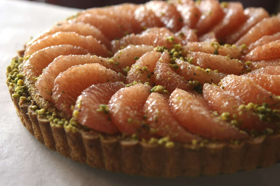 Pistachio and grapefruit tart at Chez Vatel & Bistro, where French cuisine and ambience go from formal to informal. Photo: Express-News File Photo