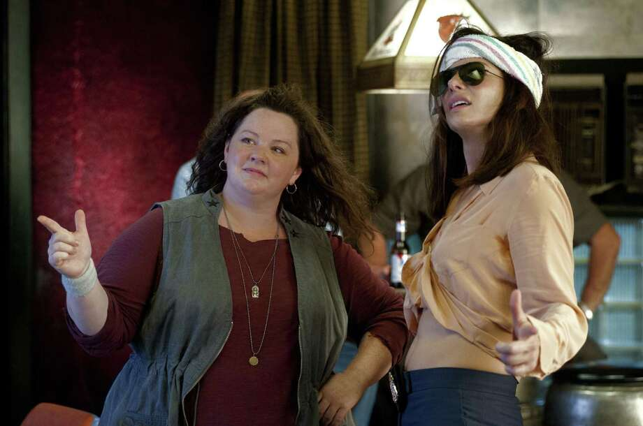 "Melissa McCarthy as Boston Detective Shannon Mullins (left) and Sandra Bullock as FBI Special Agent Sarah Ashburn star in the crime caper ""The Heat."" Photo: 20th Century Fox"