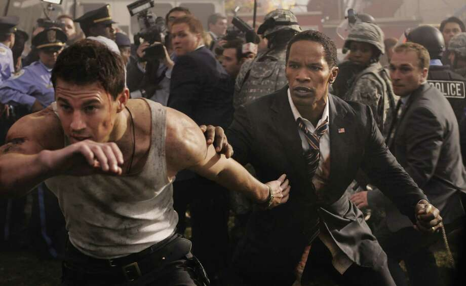"Channing Tatum (left) has the lead, but Jamie Foxx steals the show in ""White House Down."" Photo: Sony Columbia Pictures"
